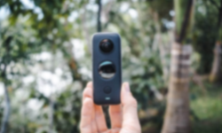 360 degree camera held in a hand