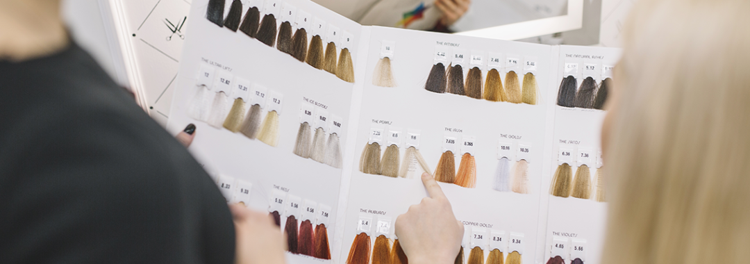 choosing from a hair colouring book