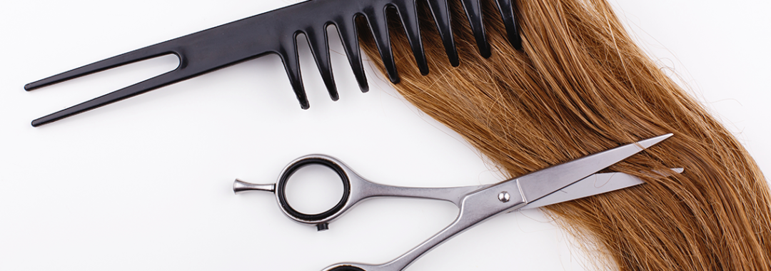 lock of hair with comb and scissors